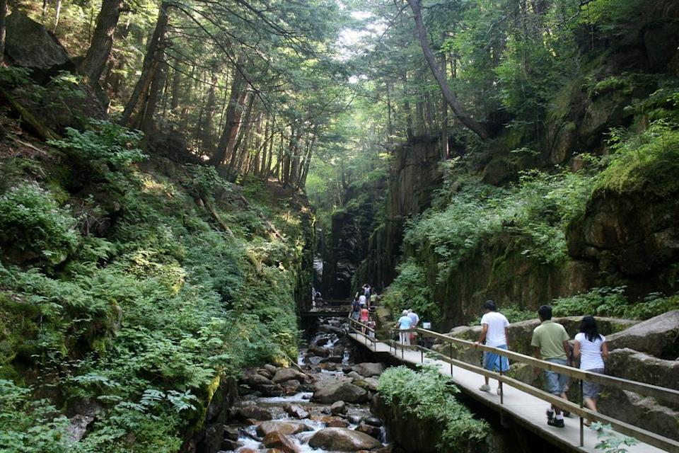 """<p>From Flume Gorge to Echo Lake, this mountain pass is easily the best place to catch the varied scenery of New Hampshire. Begin at the south end and walk the wooden bridge through Flume Gorge, before taking the <a href=""""https://www.thrillist.com/travel/nation/10-spectacular-cable-car-rides-from-around-the-world?utm_source=yahoo&utm_medium=syn&utm_term=web&utm_campaign=travel"""" rel=""""nofollow noopener"""" target=""""_blank"""" data-ylk=""""slk:aerial tram"""" class=""""link rapid-noclick-resp"""">aerial tram</a> through New England's most impressive peaks to Cannon Mountain and the New England Ski Museum. And then once you're back down, hop on the parkway and head to Echo Lake for a swim. Just so you know, though: if you came to see the famous """"Old Man on the Mountain"""" you'll be disappointed – the old rock formation that many say looked like the face of an old man collapsed in 2003. <i><i><i>(Photo:</i></i> <a href=""""https://www.flickr.com/photos/wwworks/3895258160/"""" rel=""""nofollow noopener"""" target=""""_blank"""" data-ylk=""""slk:Flickr/woodleywonderworks)"""" class=""""link rapid-noclick-resp"""">Flickr/woodleywonderworks<i>)</i></a></i></p>"""