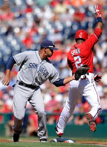 Washington Nationals' Denard Span (2) is tagged out by San Diego Padres first baseman Jesus Guzman, left, during the first inning of a baseball game on Saturday, July 6, 2013, in Washington. (AP Photo/Nick Wass)