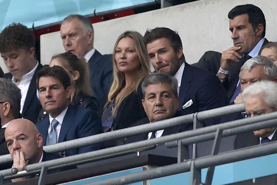 FIFA President Gianni Infantino, US actor Tom Cruise, Portuguese Soccer Federation President Fernando Gomes, former England player David Beckham and former Portugal player Luis Figo on the stands during the Euro 2020 soccer championship final match between England and Italy at Wembley stadium in London, Sunday, July 11, 2021. (Carl Recine/Pool Photo via AP)