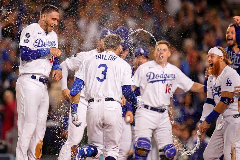The Dodgers celebrate the walk-off two run home run hit by left fielder Chris Taylor in the ninth inning.
