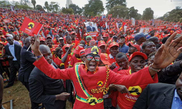 <p>Supporters of Kenya's President Uhuru Kenyatta cheer at an election rally in Uhuru Park in downtown Nairobi, Kenya, Friday, Aug. 4, 2017. (Photo: Ben Curtis/AP) </p>
