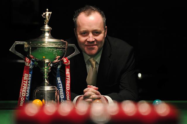 Scottish world snooker champion John Higgins poses for photographs with the winner's trophy in central London on April 11, 2012, after a press conference to mark the launch of the Snooker World Championships which run from April 21 to May 7 at the Crucible Theatre in Sheffield. AFP PHOTO / CARL COURT (Photo credit should read CARL COURT/AFP/Getty Images)