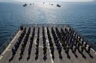 FILE PHOTO: Crew members of the amphibious landing ship tank (LST) TCG Bayraktar (L-402) pose after a landing drill during the Blue Homeland naval exercise off the Aegean coastal town of Foca in Izmir Bay