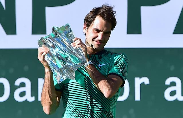Roger Federer of Switzerland lifts the trophy following his victory over compatriot Stan Wawrinka in the ATP Indian Wells Masters final match, in California, on March 19, 2017 (AFP Photo/Frederic J. Brown)