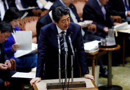 FILE PHOTO: Japan's Prime Minister Shinzo Abe answers a question during an upper house parliamentary session in Tokyo, Japan March 28, 2018. REUTERS/Issei Kato/File Photo