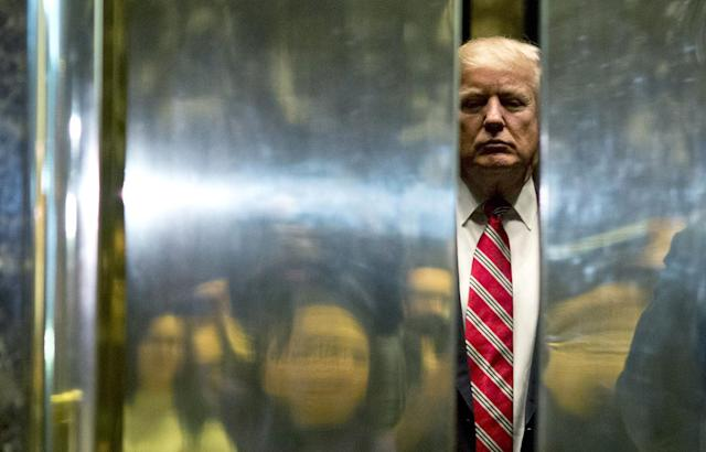 <p>U.S. President-elect Donald Trump boards the elevator after escorting Martin Luther King III to the lobby after meetings at Trump Tower in New York City on January 16, 2017. (Dominick Reuter/AFP/Getty Images) </p>