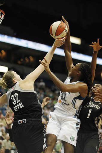 Minnesota Lynx forward Rebekkah Brunson (32) tries to grab a rebound against San Antonio Silver Stars center Jayne Appel (32) and forward DeLisha Milton-Jones (1) in the first half of a WNBA basketball game, Tuesday, June 11, 2013, in Minneapolis. (AP Photo/Stacy Bengs)
