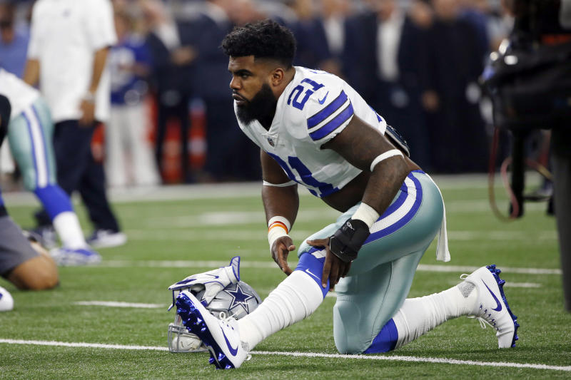Dallas Cowboys running back Ezekiel Elliott apologized for not hustling after an interception by the Broncos. (AP)