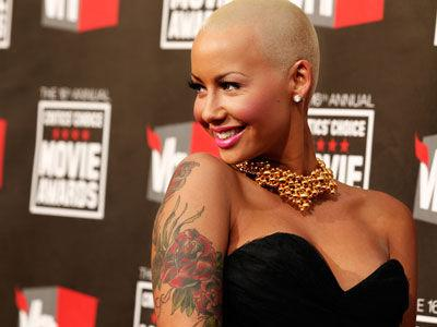 Model Amber Rose's tattoos are a distinctive feature.