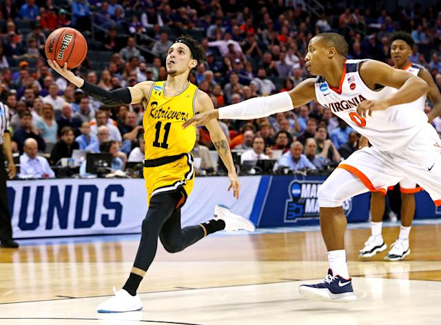 <p>No. 16 seeds had tried 135 times. No. 16 seeds had failed 135 times. And then the University of Maryland-Baltimore County Retrievers played the game of their lives on Friday night.<br>UMBC shocked No. 1 overall seed Virginia in the first round of the NCAA tournament, a result that sent shockwaves throughout college basketball, and throughout the sports world as a whole. It busted brackets and opened up paths to the Final Four San Antonio. </p>