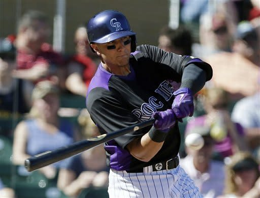 Colorado Rockies' Troy Tulowitzki hits a double against the Seattle Mariners during the fifth inning of an exhibition spring training baseball game on Saturday, March 16, 2013 in Scottsdale, Ariz. (AP Photo/Marcio Jose Sanchez)
