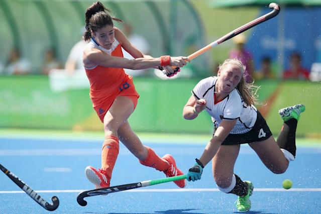 <p>Naomi van As of the Netherlands shoots at goal under pressure from Nike Lorenz of Germany who was hit on the head with her stick during the womens semifinal match between the Netherlands and Germany on Day 12 of the Rio 2016 Olympic Games at the Olympic Hockey Centre on August 17, 2016 in Rio de Janeiro, Brazil. (Photo by Mark Kolbe/Getty Images) </p>