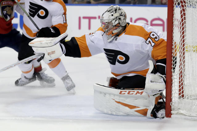 Philadelphia Flyers goaltender Carter Hart stops the puck during the first period of the team's NHL hockey game against the Florida Panthers, Thursday, Feb. 13, 2020, in Sunrise, Fla. (AP Photo/Lynne Sladky)