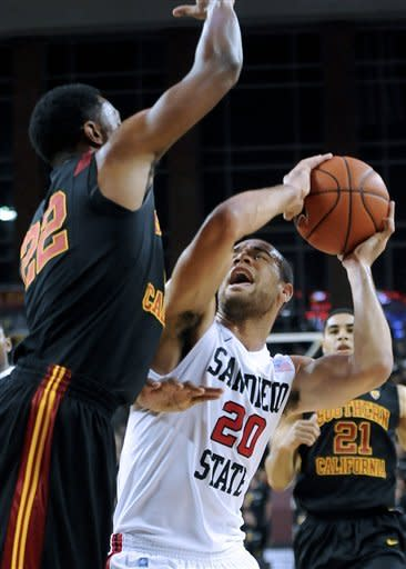 San Diego State forward JJ O'Brien (20) works against Southern California guard Byron Wesley's (22) during the first half of an NCAA college basketball game, Sunday, Nov. 25, 2012, in Los Angeles. (AP Photo/Gus Ruelas)