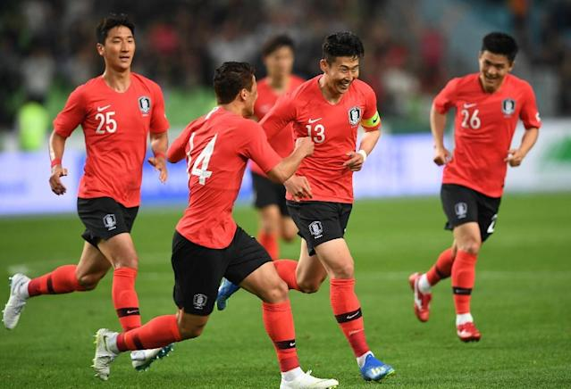 South Korea's Son Heung-min (2R) celebrates his goal during a friendly football match against Honduras in Deagu on May 28, 2018 (AFP Photo/Jung Yeon-je)