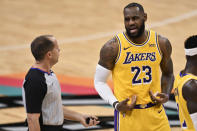 Los Angeles Lakers' LeBron James (23) talks to referee John Goble during the first half of the team's NBA basketball game against the San Antonio Spurs, Friday, Jan. 1, 2021, in San Antonio. (AP Photo/Darren Abate)