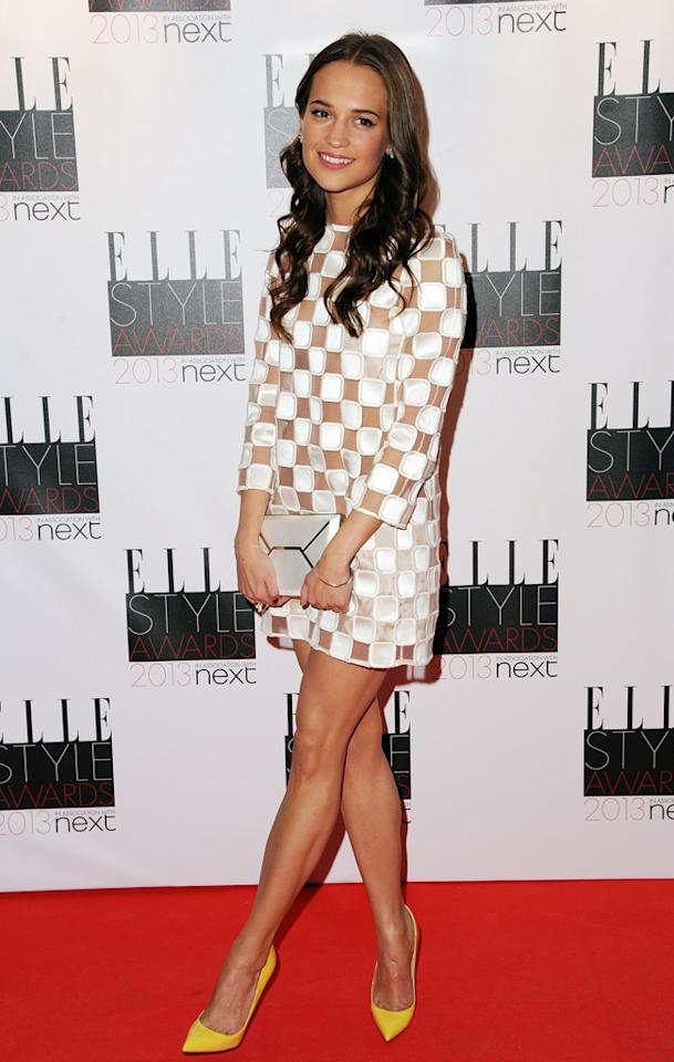 "The following night, ""Anna Karenina"" co-star -- Swedish actress Alicia Vikander -- turned heads upon arriving at the Elle Style Awards at London's Savoy Hotel in a darling Louis Vuitton mini and pointy, mustard-hued pumps. A week ago, we would have told you that the checkered trend was tired, but we simply can't deny the adorableness of this dress. Can you? (2/11/2013)"