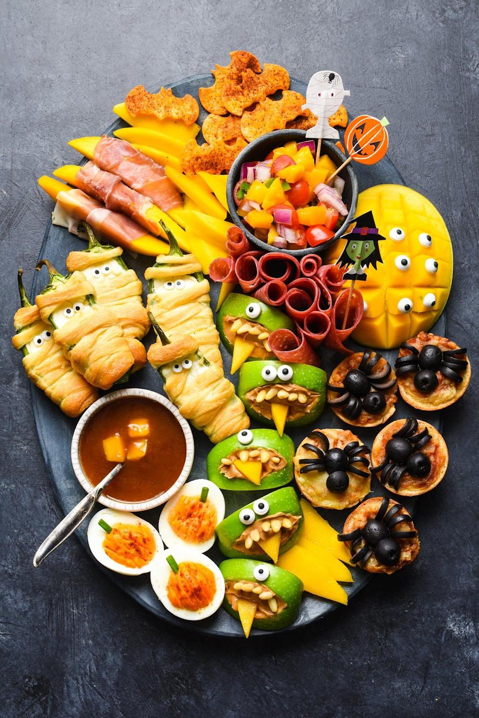 "<p>If you're in the mood for a casual and cool dinner, this Halloween-themed plate is for you. It features jalapeño popper mummies with mango sweet-and-sour sauce, spider pizzas, pumpkin deviled eggs, and more. What else could you want?!</p> <p><strong>Get the recipe:</strong> <a href=""https://foxeslovelemons.com/halloween-snack-dinner/"" class=""link rapid-noclick-resp"" rel=""nofollow noopener"" target=""_blank"" data-ylk=""slk:mummy, spider, and bat plate"">mummy, spider, and bat plate</a></p>"
