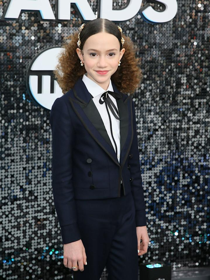 <p>Chloe Coleman stole the show with her gold hair accessories and natural makeup.</p>