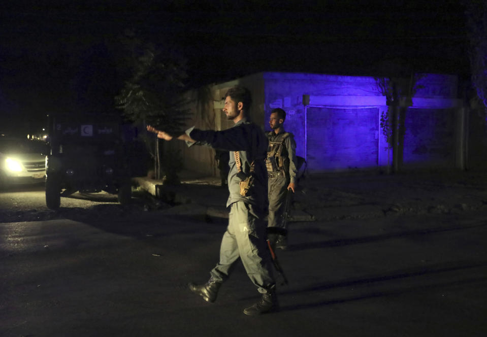 Afghan security personnel arrive at the site of a bomb explosion in Kabul, Afghanistan, Tuesday, June 1, 2021. An Afghan government spokesman says two bombs exploded in quick succession in separate locations of a neighborhood in west Kabul, leaving multiple people dead and wounded. (AP Photo/Rahmat Gul)