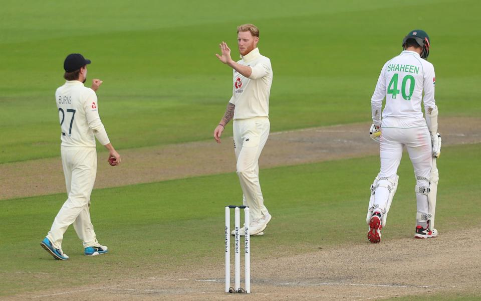 Ben Stokes of England celebrates with Rory Burns after taking the wicket of Shaheen Afridi - GETTY IMAGES