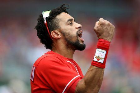 FILE PHOTO: Jul 29, 2018; Cincinnati, OH, USA; Cincinnati Reds center fielder Billy Hamilton (6) reacts from the dugout against the Philadelphia Phillies in the fifth inning at Great American Ball Park. Mandatory Credit: Aaron Doster-USA TODAY Sports