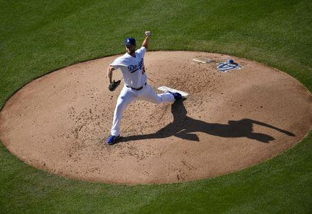May 31, 2018; Los Angeles, CA, USA; Los Angeles Dodgers pitcher Clayton Kershaw (22) pitches during the second inning against the Philadelphia Phillies at Dodger Stadium. Mandatory Credit: Kelvin Kuo-USA TODAY Sports