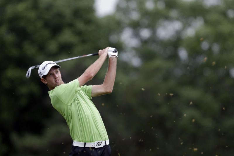 Webb Simpson tees off on the ninth hole during the first round of the U.S. Open golf tournament at Merion Golf Club, Thursday, June 13, 2013, in Ardmore, Pa. (AP Photo/Gene J. Puskar)