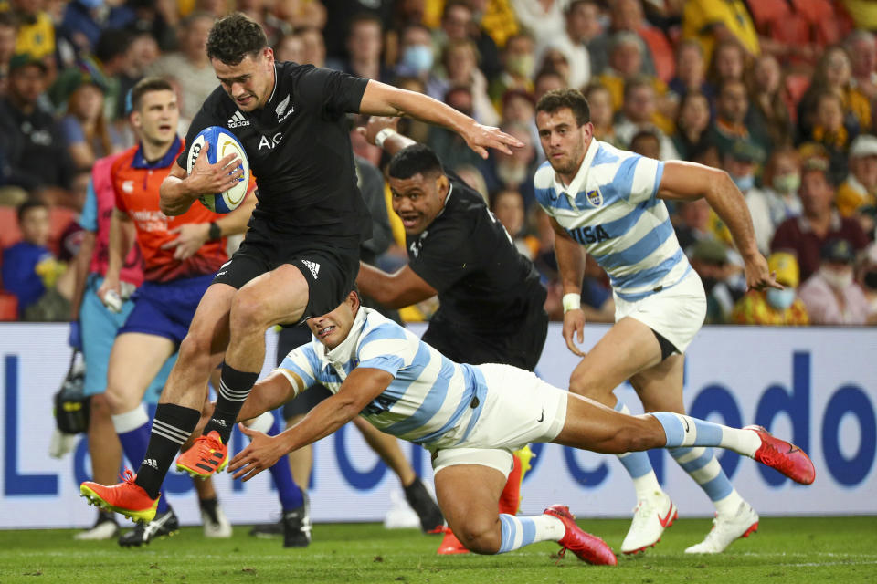 New Zealand's Will Jordan leaps clear of the defense during the Rugby Championship test match between the All Blacks and the Pumas in Brisbane, Australia, Saturday, Sept. 18, 2021. (AP Photo/Tertius Pickard)