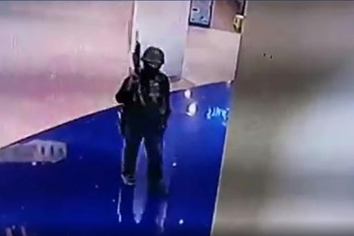 Barricaded Thai shoppers were able to receive updates on the movements of the soldier gunman via CCTV, from which this video grab came after a release by a Thai television station