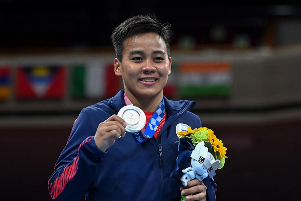 Silver medallist Philippines' Nesthy Petecio poses on the podium with her medal after the women's featherweight boxing final bout at the 2020 Tokyo Olympics.