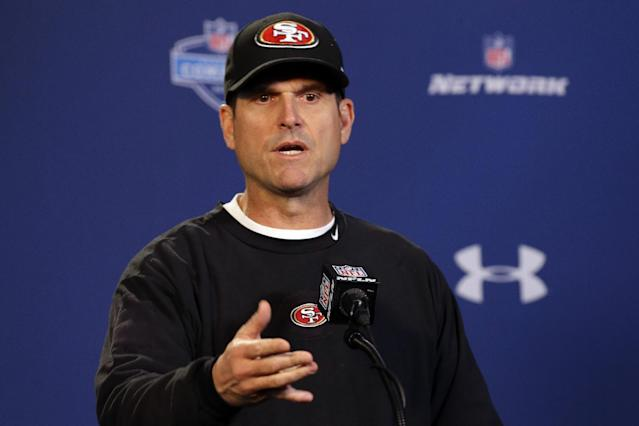 San Francisco 49ers head coach Jim Harbaugh answers a question during a news conference at the NFL football scouting combine in Indianapolis, Thursday, Feb. 20, 2014. (AP Photo/Michael Conroy)