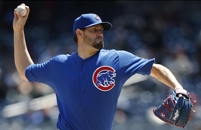 Chicago Cubs starting pitcher Jason Hammel delivers in the first inning of the first game of an interleague baseball doubleheader against the New York Yankees at Yankee Stadium in New York, Wednesday, April 16, 2014. (AP Photo/Kathy Willens)