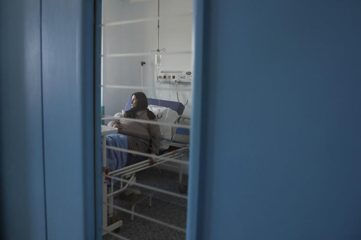 A Covid-19 patient sits on her bed at the COVID-19 ward of Amir Al-Momenin hospital in the city of Qom, some 80 miles (125 kilometers) south of the capital Tehran, Iran, Wednesday, Sept. 15, 2021. (AP Photo/Vahid Salemi)