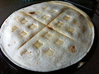 """<p>Now you don't have to worry about the cheese oozing out.</p><p>Get the recipe from <a rel=""""nofollow noopener"""" href=""""http://momommamoney.blogspot.com/2011/07/recipe-waffle-chicken-cheese-quesadilla.html"""" target=""""_blank"""" data-ylk=""""slk:MoMomma"""" class=""""link rapid-noclick-resp"""">MoMomma</a>.</p>"""