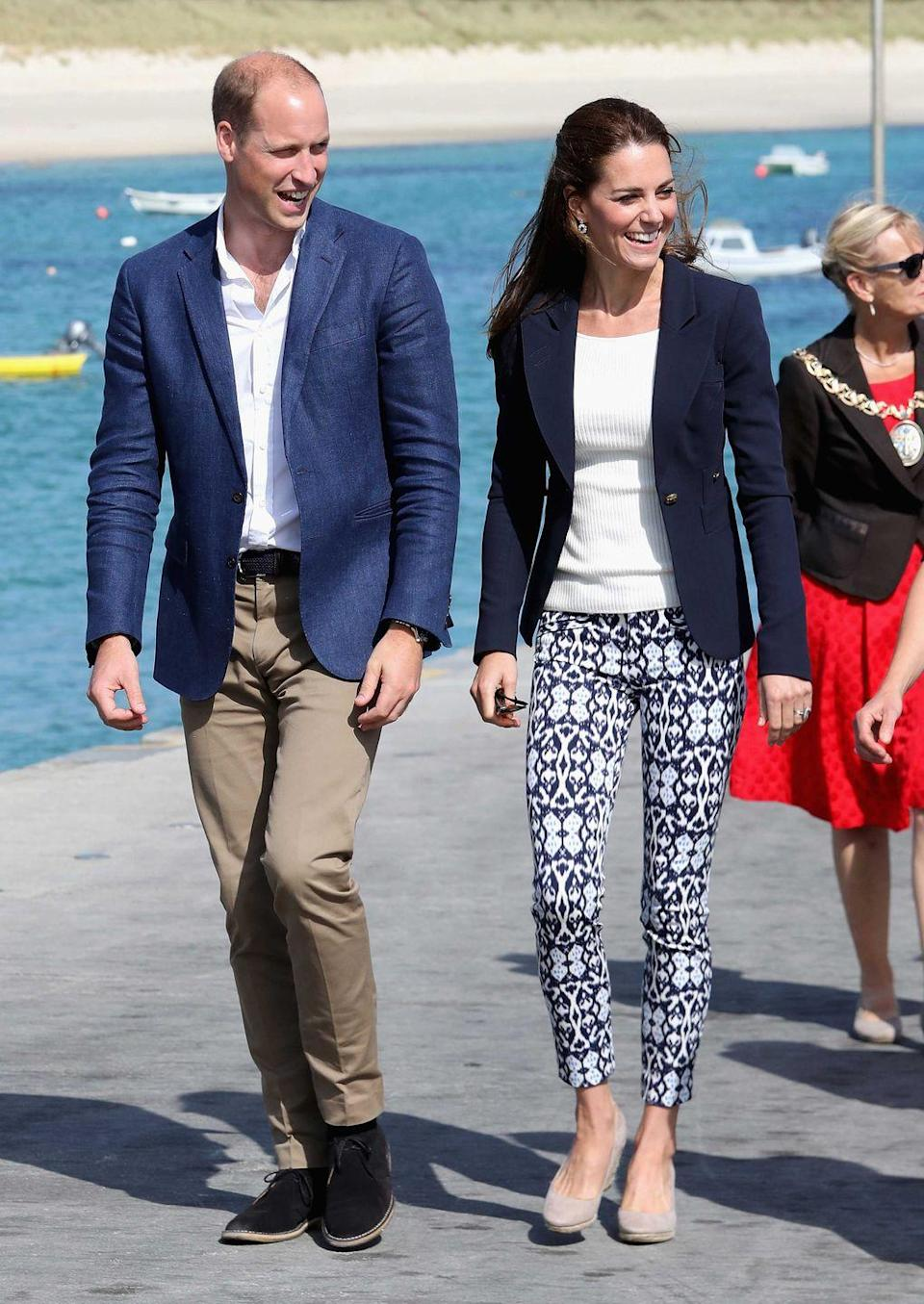 """<p>Kate's pants are from the <a href=""""https://go.redirectingat.com?id=74968X1596630&url=http%3A%2F%2Fwww.gap.com%2Fbrowse%2Fproduct.do%3Fpid%3D130046282%26vid%3D1%26locale%3Den_US%26kwid%3D1%26sem%3Dfalse%26sdkw%3Dbi-stretch-skinny-ankle-pants-P130046%26sdReferer%3Dhttps%253A%252F%252Fwww.google.com%252F&sref=https%3A%2F%2Fwww.townandcountrymag.com%2Fstyle%2Ffashion-trends%2Fnews%2Fg1633%2Fkate-middleton-fashion%2F"""" rel=""""nofollow noopener"""" target=""""_blank"""" data-ylk=""""slk:Gap"""" class=""""link rapid-noclick-resp"""">Gap</a>. Yes, you read that right. (Prince William and the Duchess were visiting the Island of St Martin's in England's Scilly Isles.)</p>"""