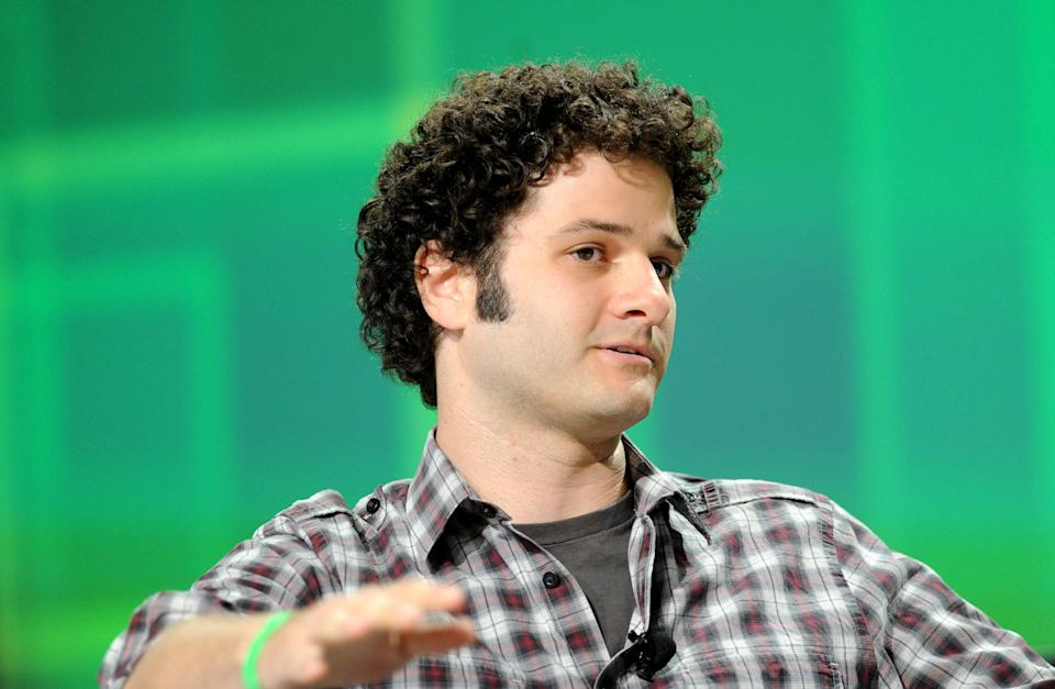 """Dustin Moskovitz, co-founder of Facebook Inc., speaks at the TechCrunch Disrupt conference in San Francisco, California, U.S., on Monday, Sept. 12, 2011. More than 2,000 attendees are expected at the conference and 30 startup companies are planning to launch as part of the """"Startup Battlefield"""" program. Photographer: Noah Berger/Bloomberg via Getty Images"""