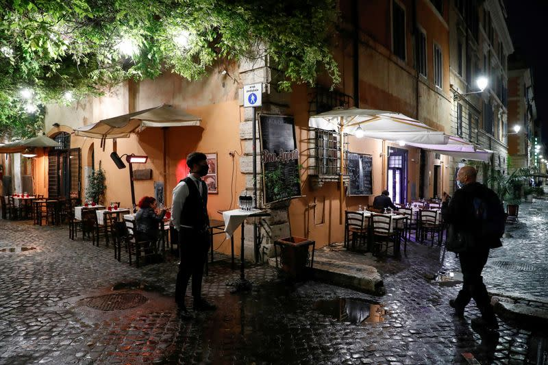FILE PHOTO: Empty tables are seen outside a restaurant in Rome as the country tightens regulations in an effort to control rising COVID-19 infections