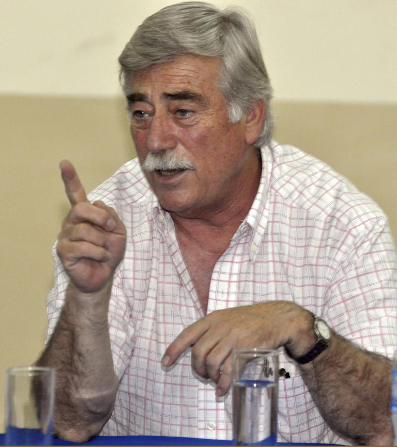 In this photo taken Dec. 30, 2011, Carlos Soria, governor of the southern Argentine province of Rio Negro, talks to farmers in General Roca, Argentina. Soria, 62, who had just taken office on Dec. 9, was shot to death Sunday, Jan. 1, 2012 near General Roca, according to Rio Negro's province spokesman Julian Goinhex. The circumstances of Soria's death are under investigation.  (AP Photo/Telam)