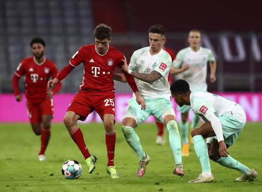 Bayern's Thomas Muller, front left, duels for the ball with Bremen's Marco Friedl during the German Bundesliga soccer match between FC Bayern Munich and SV Werder Bremen in Munich, Germany, Saturday, Nov. 21, 2020. (AP Photo/Matthias Schrader)