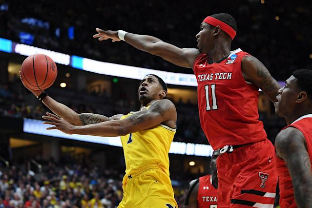 <p>Charles Matthews #1 of the Michigan Wolverines drives to the basket against Tariq Owens #11 of the Texas Tech Red Raiders during the 2019 NCAA Men's Basketball Tournament West Regional at Honda Center on March 28, 2019 in Anaheim, California. (Photo by Harry How/Getty Images) </p>