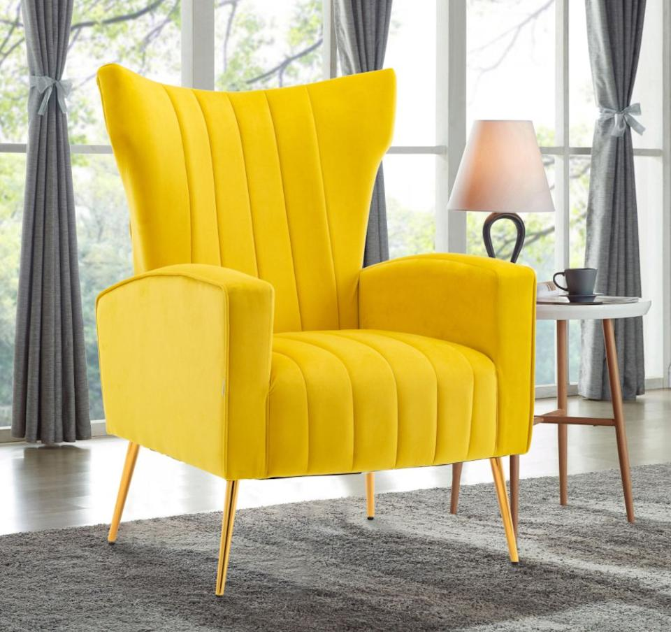 """With a comfortable seat cushion andmetal frame, this chair is made to last. What we especially love is the gold hairpin-like legs and bright color. (But it comes in beige, gray and pink, too.)<a href=""""https://fave.co/2J13R03"""" target=""""_blank"""" rel=""""noopener noreferrer"""">Originally $326, get it now for $182 at The Home Depot</a>."""