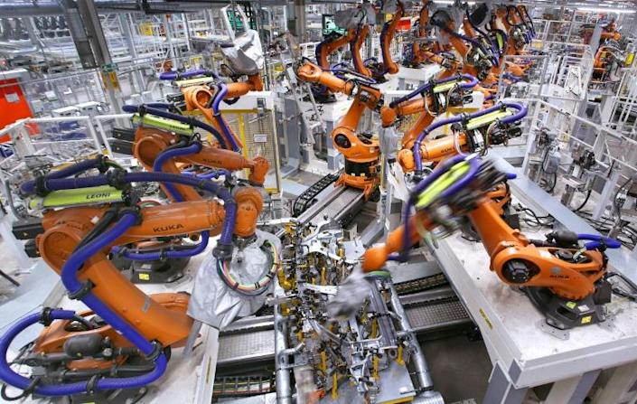 Germany's key automotive sector is suffering from a shortage of semiconductors, a component in both conventional and electric vehicles (AFP/RONNY HARTMANN)