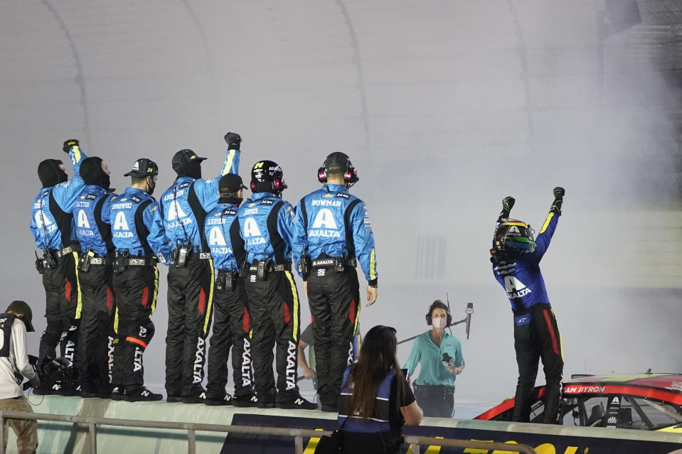 William Byron, right, celebrates with his crew after winning a NASCAR Cup Series auto race, Sunday, Feb. 28, 2021, in Homestead, Fla. (AP Photo/Wilfredo Lee)