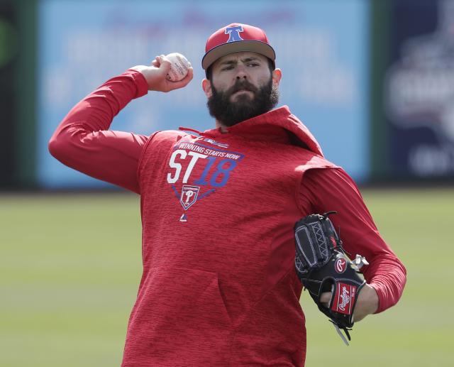 FILE - In this March 13, 2018, file photo, Philadelphia Phillies pitcher Jake Arrieta throws during a work out before a spring baseball exhibition game against the Tampa Bay Rays, in Clearwater, Fla. When free-agent ace Jake Arrieta arrived at spring training on co-owner John Middleton's private plane, it signaled the start of a new era for this franchise.(AP Photo/John Raoux, File)