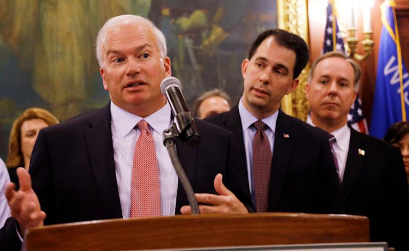 Wisconsin state Senate President Scott Fitzgerald (left), Gov. Scott Walker (center) and Assembly Speaker Robin Vos -- all Republicans -- have led an effort to rein in the powers of statewide offices that Democrats won from the GOP in November. (Photo: ASSOCIATED PRESS)