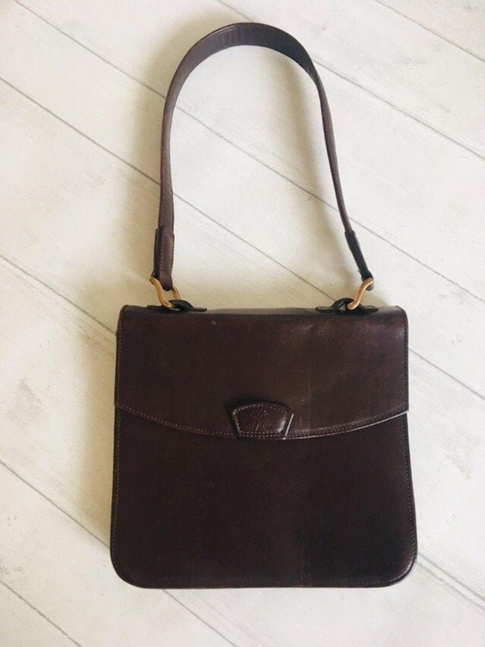 "If I'm gonna buy big labels, I'm gonna buy them secondhand, and this is an absolute winner. I love the colour, the shape, the size. I've been falling back on tote bags for too long! It's time to change it up again.<br><br><strong>Mulberry</strong> Dark Brown Shoulder Bag, $, available at <a href=""https://www.etsy.com/uk/listing/733039201/vintage-mulberry-shoulder-bagstructured?"" rel=""nofollow noopener"" target=""_blank"" data-ylk=""slk:Etsy"" class=""link rapid-noclick-resp"">Etsy</a>"