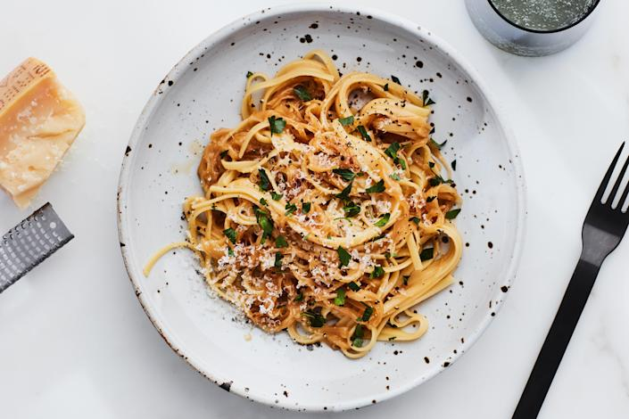 """Check your kitchen right now: All you need for this easy dinner is boxed pasta, onions, garlic, and Parmesan. The caramelized onions bring a luscious sweetness—consider making a double batch and <a href=""""https://www.epicurious.com/expert-advice/freeze-caramelized-onions-in-ice-cube-tray-article?mbid=synd_yahoo_rss"""" rel=""""nofollow noopener"""" target=""""_blank"""" data-ylk=""""slk:freezing them"""" class=""""link rapid-noclick-resp"""">freezing them</a> for future meals. <a href=""""https://www.epicurious.com/recipes/food/views/caramelized-onion-pasta?mbid=synd_yahoo_rss"""" rel=""""nofollow noopener"""" target=""""_blank"""" data-ylk=""""slk:See recipe."""" class=""""link rapid-noclick-resp"""">See recipe.</a>"""