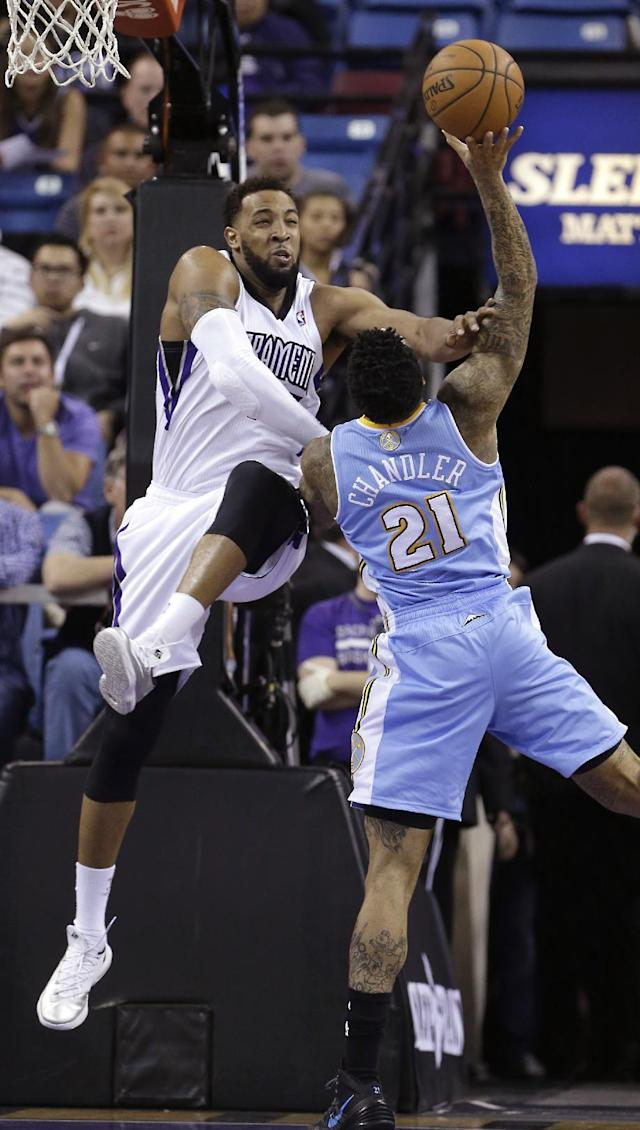 Denver Nuggets forward Wilson Chandler, right, is fouled by Sacramento Kings forward Derrick Wilson during the third quarter of an NBA basketball game in Sacramento, Calif., Sunday, Jan. 26, 2014. The Nuggets won 125-117.(AP Photo/Rich Pedroncelli)