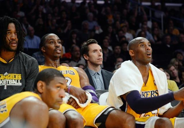 A towel used by Kobe Bryant, far right, during his final NBA game has been sold at auction for $33,000 (AFP Photo/KEVORK DJANSEZIAN)